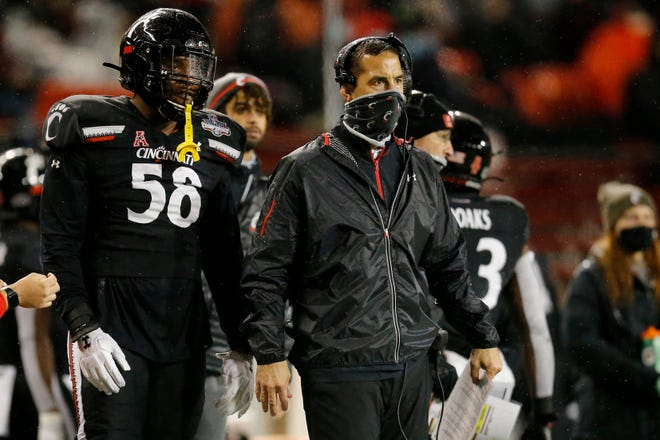 """""""We need to give a team like Cincinnati an opportunity to be in the Playoffs, (and that's) the only way we're going to do that,"""" UC head coach Luke Fickell said of expanding the College Football Playoff."""