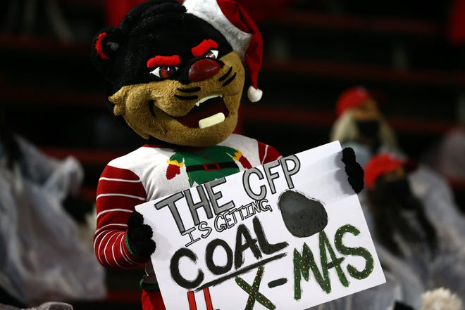 The Cincinnati Bearcats mascot performs in the first quarter during the American Athletic Conference football championship game between the Tulsa Golden Hurricane and the Cincinnati Bearcats, Saturday, Dec. 19, 2020, at Nippert Stadium in Cincinnati.
