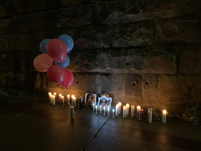 A vigil for Nyteisha and Nylo Lattimore was held Saturday evening near the Purple People Bridge.