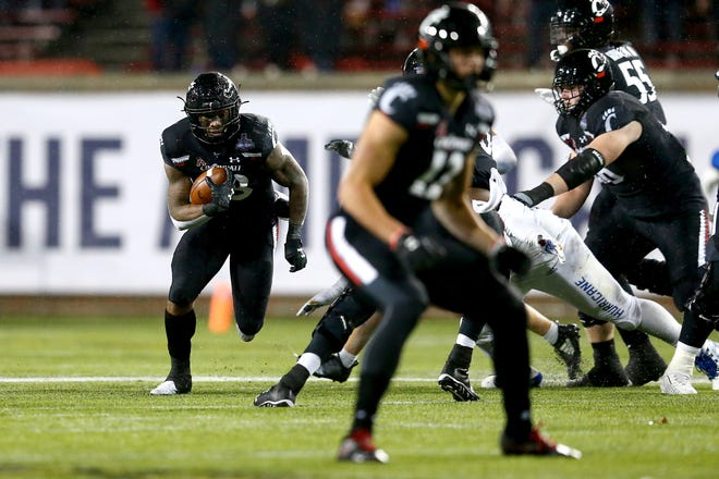 Cincinnati Bearcats running back Gerrid Doaks (23) carries the ball in the second quarter during the American Athletic Conference football championship game against the Tulsa Golden Hurricane, Saturday, Dec. 19, 2020, at Nippert Stadium in Cincinnati.