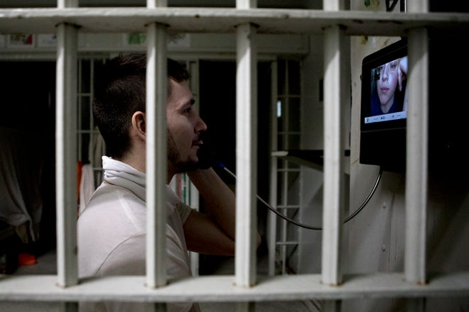 Dallas Wood speaks with his girlfriend, Justice Dawson while in cell block A at the Coschoton County Justice Center. The Justice Center has added video cameras that allow inmates to see their loved ones while in jail during the pandemic and in person visits are not allowed.