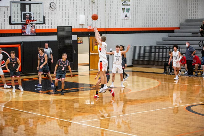 Kole Hamilton fires up a three for Ridgewood in the first half of a high school boys basketball game against Sandy Valley in West Lafayette on Saturday night. The Generals won 62-39.