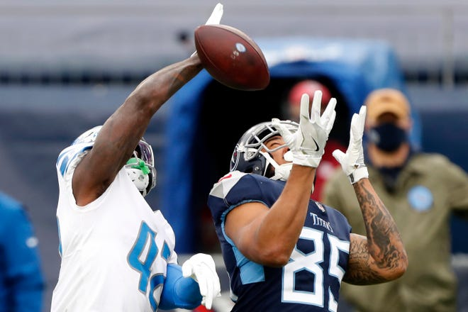 Tight end MyCole Pruitt of the Tennessee Titans has a pass knocked away by Detroit Lions safety Jayron Kearse during the first quarter at Nissan Stadium on Dec. 20, 2020 in Nashville, Tenn.