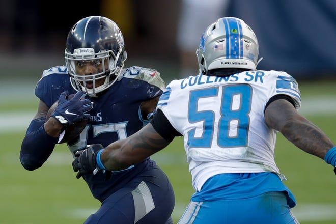 Tennessee Titans berlari kembali Derrick Henry berlari melewati Detroit Lions di luar gelandang Jamie Collins.