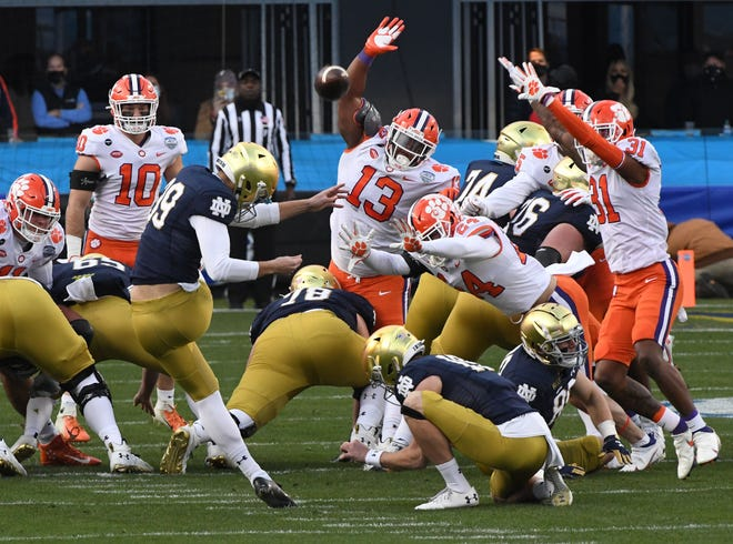 Clemson defensive tackle Tyler Davis(13) reaches as Notre Dame senior Jonathan Doerer(39) makes a 51-yard field goal during the first quarter of the ACC Championship game Dec 19, 2020; Charlotte, NC, USA;  at Bank of America Stadium. Mandatory Credit: Ken Ruinard-USA TODAY Sports