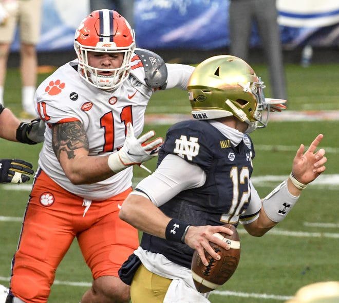 Clemson defensive lineman Bryan Bresee(11) pressures Notre Dame quarterback Ian Book(12) during the first quarter of the ACC Championship game Dec 19, 2020; Charlotte, NC, USA;  at Bank of America Stadium. Mandatory Credit: Ken Ruinard-USA TODAY Sports