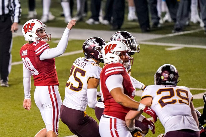 Collin Larsh watches his kick split the uprights in overtime as he helps send Wisconsin past Minnesota.