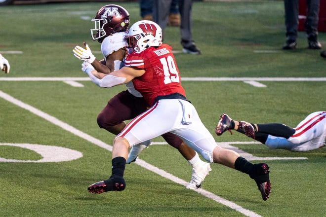 Wisconsin linebacker Nick Herbig takes down Minnesota running back Mohamed Ibrahim last season.