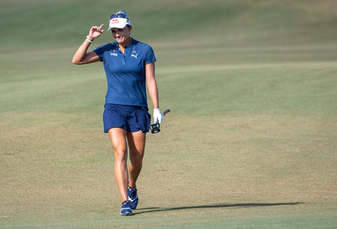 Lexi Thompson waves to the small crowd as she approaches the green on 18 during the final round of the CME Group Tour Championship golf tournament on Sunday, December 20, at Tiburon Golf Club in Naples.