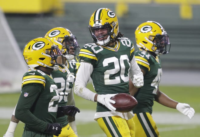 Green Bay Packers cornerback Kevin King (20) celebrates a fumble recovery for a huge gain against the Carolina Panthers during their football game Saturday, December 19, 2020, at Lambeau Field in Green Bay, Wis.