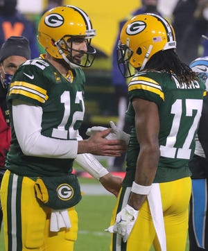 Green Bay Packers quarterback Aaron Rodgers (12) celebrates his six-yard touchdown run with wide receiver Davante Adams (17) during the second quarter of their game against the Carolina Panthers Saturday, December 19, 2020 at Lambeau Field in Green Bay, Wis.