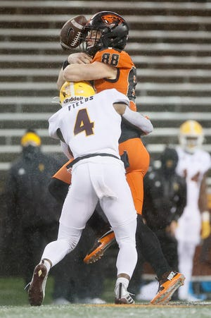 Dec 19, 2020; Corvallis, Oregon, USA; Oregon State Beavers tight end Luke Musgrave (88) is hit by Arizona State Sun Devils defensive back Evan Fields (4) after making a catch during the first half at Reser Stadium. Mandatory Credit: Soobum Im-USA TODAY Sports