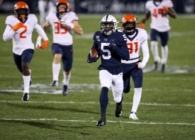 Dec 19, 2020; University Park, Pennsylvania, USA; Penn State Nittany Lions wide receiver Jahan Dotson (5) returns the ball for a touchdown during the first quarter against the Illinois Fighting Illini at Beaver Stadium. Mandatory Credit: Matthew OHaren-USA TODAY Sports