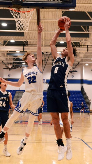 Granville's Carsyn Crouch goes up for a shot over Zanesville's Briar Harmon during a 70-54 win in a Licking County League game on Saturday night at Winland Memorial Gymnasium.