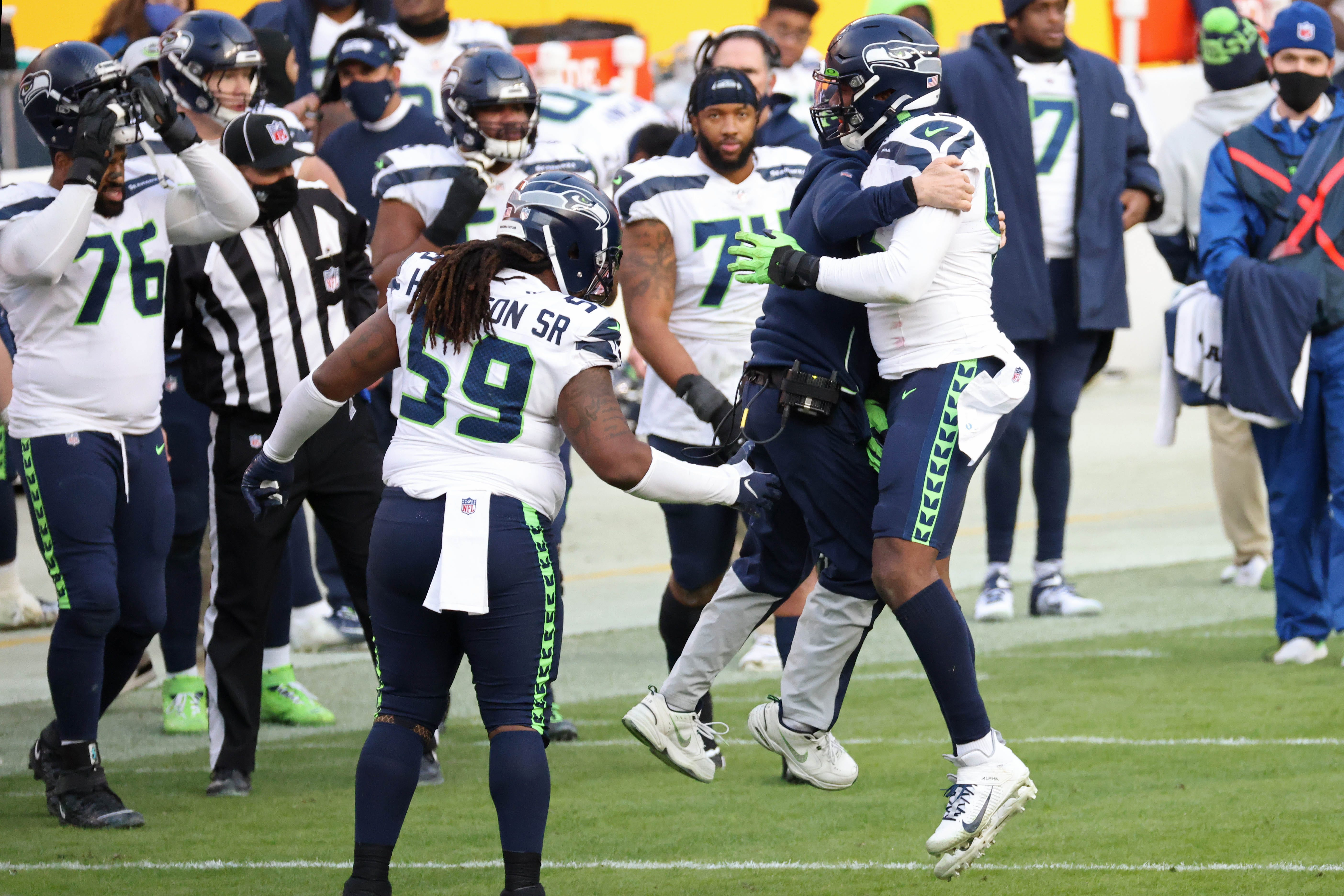 NFL playoff picture after Week 15: Seahawks clinch spot, assume first place in NFC West, as Rams stumble