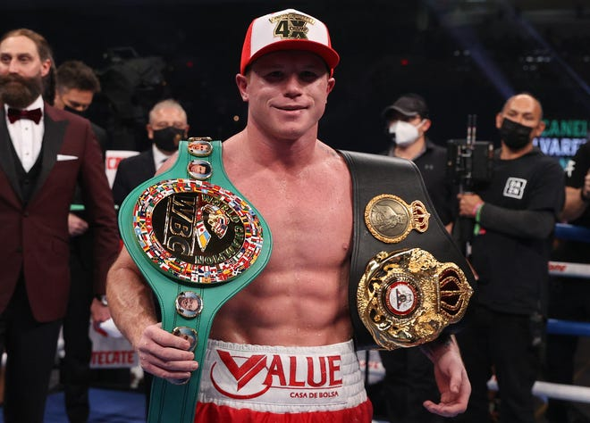 Canelo Alvarez celebrates his unanimous-decision victory over Callum Smith.