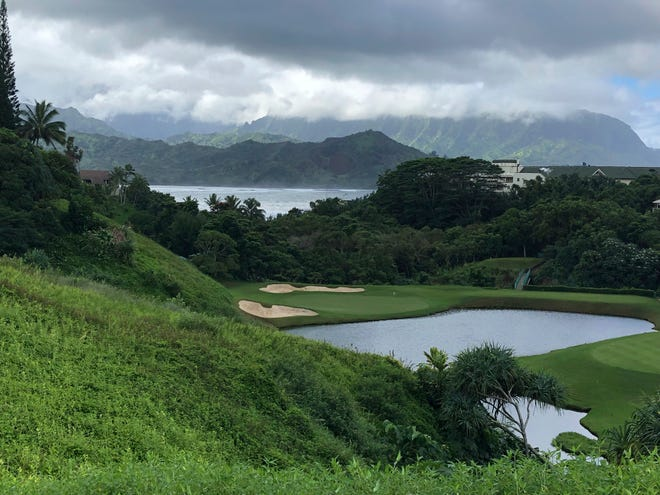 In this Nov. 16, 2018 file photo, clouds hang over a golf course near Kauai's Hanalei Bay in Princeville, Hawaii.