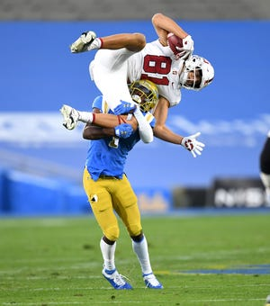 Stanford wide receiver Brycen Tremayne is upended by UCLA defensive back Jay Shaw after catching a pass in the first half at the Rose Bowl.