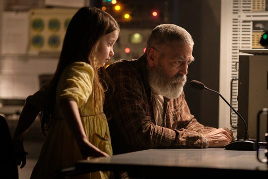 """Augustine (George Clooney, with Caoilinn Springall) attempts to communicate with a returning spaceship in """"The Midnight Sky."""""""