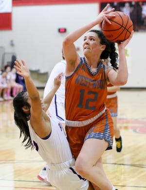 Westwood forward Desi Davalos, fighting through a Cedar Ridge block attempt last year, led the Warriors to wins over McNeil and Round Rock last week.