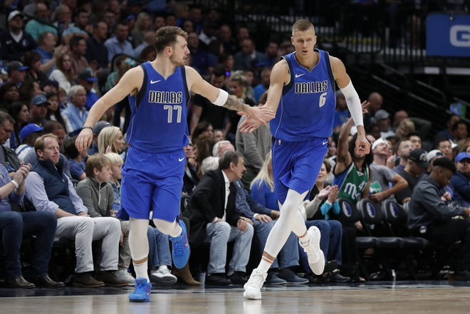The Mavericks are counting on Luka Doncic, left, and Kristaps Porzingis to lead the team on a deeper playoff run in their second season together.