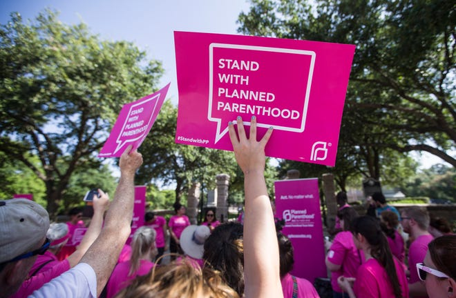 Supporters of Planned Parenthood are shown in 2015 rallying outside of the Texas Capitol. The state's executive action to exclude Planned Parenthood affiliates from participating in Medicaid took effect Dec. 15.