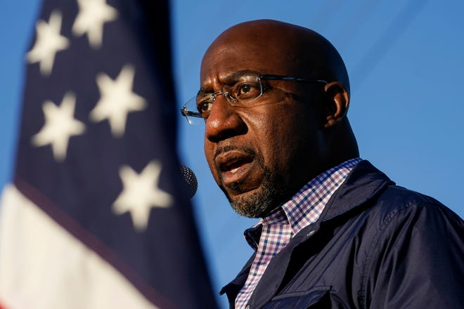 In this Nov. 15, 2020, file photo, the Rev. Raphael Warnock, a Democratic candidate for the U.S. Senate, speaks during a campaign rally in Marietta. (AP Photo/Brynn Anderson, File)