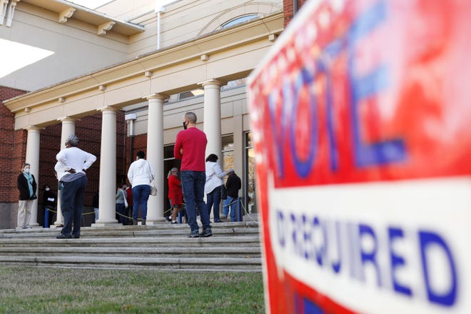 Voters line up on the first day of early voting for Georgia's two U.S. Senate runoffs at the Lyndon House Arts Center in Athens, Ga., on Monday, Dec. 14, 2020. (Photo/Joshua L. Jones, Athens Banner-Herald)