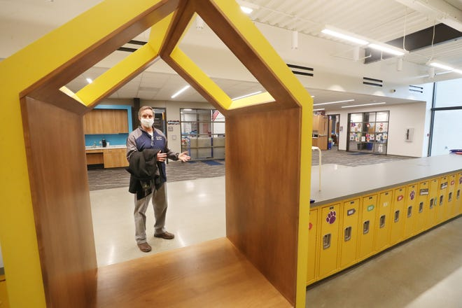 Superintendent Jeff Ferguson talks about a small study area as he talks about the new Tallmadge Elementary School on Monday, Dec. 21, 2020 in Tallmadge. [Mike Cardew/Beacon Journal]