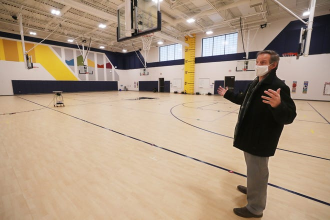 Superintendent Jeff Ferguson shows off the gym during a tour of the new Tallmadge Elementary School on Monday, Dec. 21, 2020 in Tallmadge. [Mike Cardew/Beacon Journal]