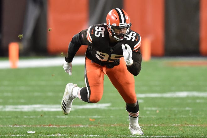 Cleveland Browns defensive end Myles Garrett (95) rushes the passer during an NFL football game against the Baltimore Ravens, Monday, Dec. 14, 2020, in Cleveland. The Ravens won 47-42. (AP Photo/David Richard)