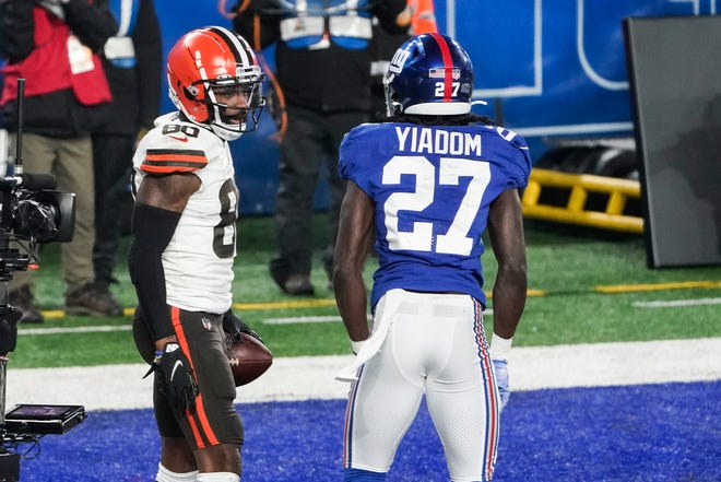 Browns' Jarvis Landry (80) celebrates after scoring a touchdown in front of New York Giants' Isaac Yiadom (27) during the first half Sunday, Dec. 20, 2020, in East Rutherford, N.J. Landry was given a penalty for taunting on the play. [Seth Wenig/Associated Press]