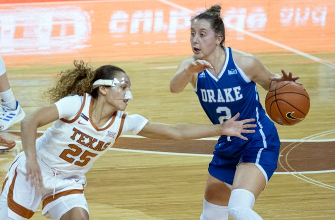 Texas freshman Ashley Chevalier (25) attempts to steal the basketball from Drake's Maddie Monahan (2) in Austin on Dec. 18, 2020.