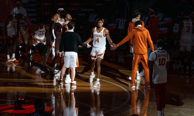 Texas freshman Greg Brown (4) is introduced before a basketball game against Oklahoma State at the Frank Erwin Center, in Austin, Texas, on Dec. 20, 2020.