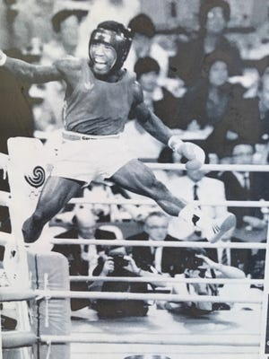 US boxer Ray Mercer, of Augusta, leaps for joy after winning the Olympic gold medal in boxing in 1988.