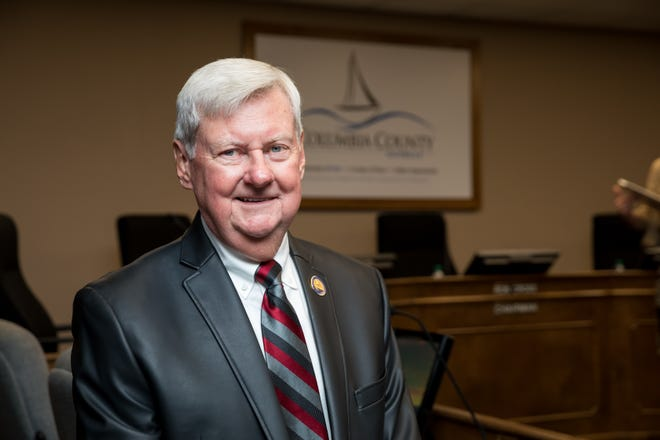 In this 2018 photo, Columbia County Board of Commissioners Chairman Ron Cross stands in commission chambers at the Columbia County Government Center in Evans.