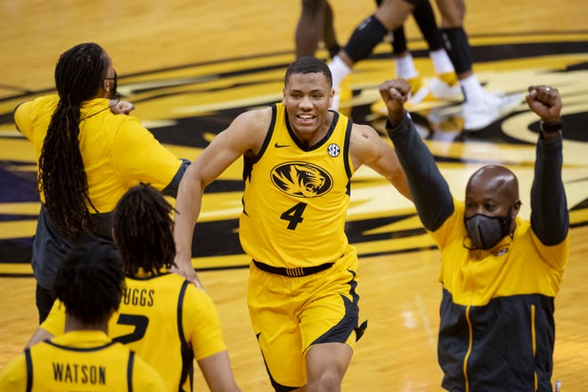 No. 14 Missouri's Javon Pickett celebrates with teammates after the Tigers defeated Illinois 81-78 in the annual Braggin' Rights game Dec. 12.