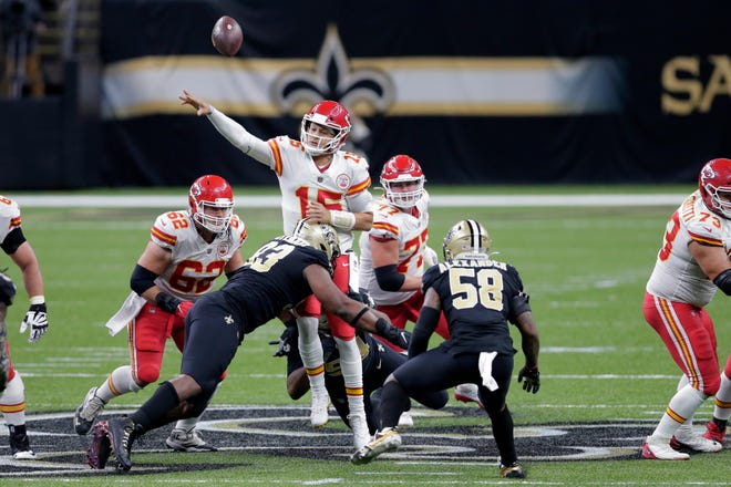 Kansas City Chiefs quarterback Patrick Mahomes (15) is hit by New Orleans Saints defensive tackle David Onyemata (93) as he passes in New Orleans, Sunday.