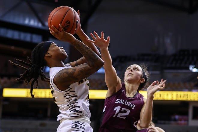 Missouri's Shug Dickson, left, shoots the ball during a game against Southern Illinois on Sunday at Mizzou Arena.