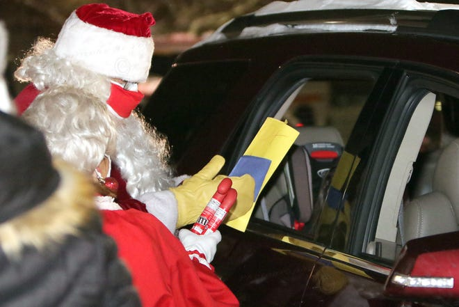 "St. Nick was on hand Dec. 27 for a ""Drive Thru with Santa"" event at the Yates County office building, in which kids could visit with Santa Claus from their vehicles."