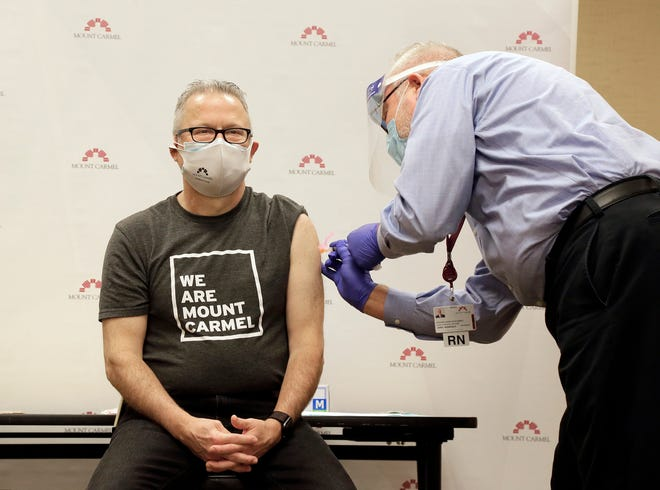 Dr. Mark Herbert, an infectious disease physician, believes that even though the COVID pandemic is a year old, it could be another year before such restrictions as masking and social distancing can be relaxed. He received his vaccine in December.