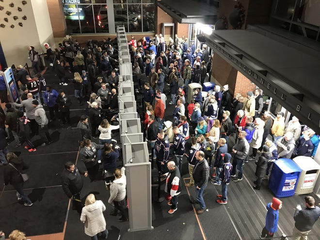 Fans enter Nationwide Arena for a Blue Jackets game on Feb. 2.