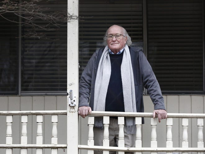 John McGory, on the front porch of his Worthington home, was retiring after six years of teaching English at a university in Wuhan, China, when found himself at the epicenter of the world coronavirus pandemic. So far, he has managed to avoid getting COVID-19.