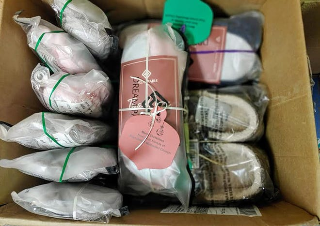 The members of First United Methodist Church worked together to provide socks and slippers to the nursing home population of Dodge City.