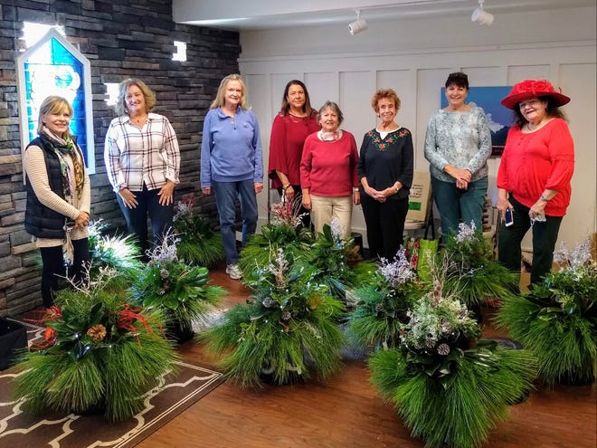 Native greenery centerpieces created by Seagrove Garden Club members were raffled off to raise funds for the group's virtual Gifting and Giving program. Members include Linda Romano, left, Cora Brettel, Patsy Powell, Marie Spafford, Ann Simpson, Rose Rogers, Eileen O'Grady and Sally Orlosky.