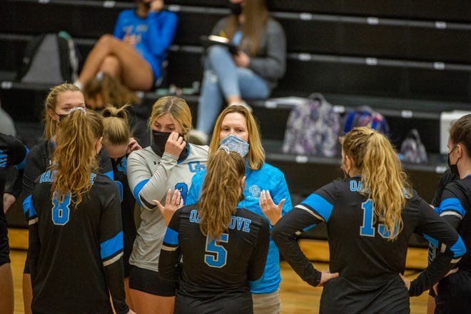 Oak Grove coach Cherie Bowman talks to her team during a match against North Davidson on Nov. 23. The Grizzlies clinched a state playoff berth Friday night with a win over Thomasville.