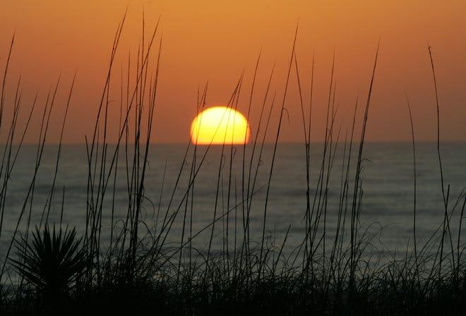 The sun rises north of Ormond Beach.