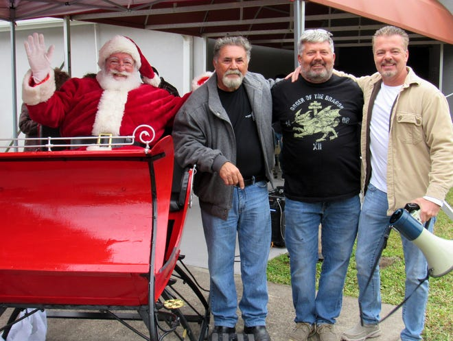 Palm Coast Santa, Carlo Celico, Lee Schults and Kevin Byrne help support the mission of the Frank Celico Foundation to provide bicycles to children in Flagler County each holiday season.