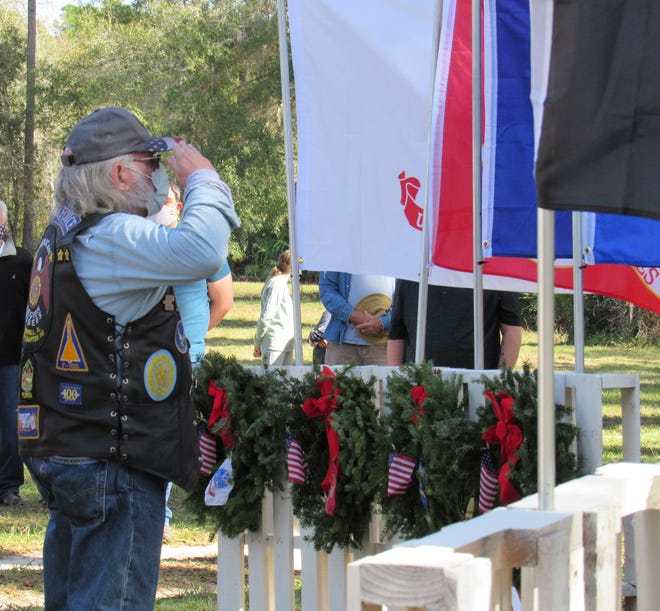 American Legion Rider Post 115 member Gary Owens salutes after placing the wreath for the U.S. Air Force during the inaugural Wreaths Across America Ceremony at Espanola Cemetery on Saturday, Dec. 19.