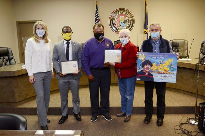 Donaldsonville Mayor Leroy Sullivan honors the family of the late Shawn Elizabeth Guillot for their advocacy of organ donation Dec. 15. Shown, from left, are: Lori Steele, Tre Sullivan, Mayor Leroy Sullivan, Peggy Guillot, and Don Guillot.